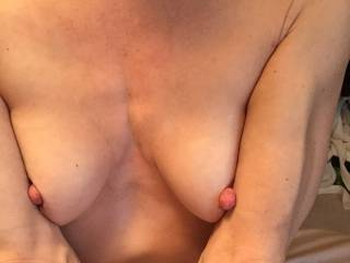 Georgeus nipples! Love to suck them, pinch them, rub my cock between those two beauties