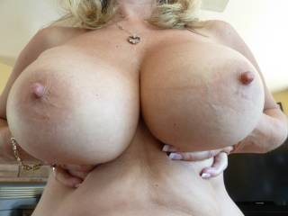 My Gf holding her big tits up for your pleasure