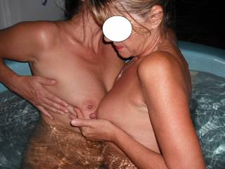 Mrs Oz has fun with in the spa with our swinger friend when they came around for a play.