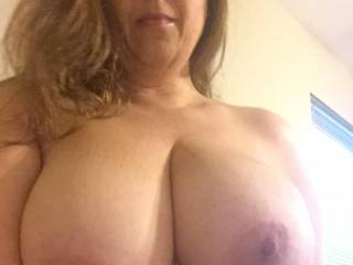 My hubby\'s favorite shot. Who wants to shoot their load all over my tits and face?