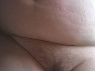 Wife laying on her side big wobbly belly flopped over and hairy pussy. Needs cum don\'t you think?