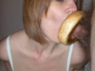 great pic. very funny and very sexy at the same time. I really love the way her cheeks are sucked in. Man I wish that was my cock that bagel was encircling.