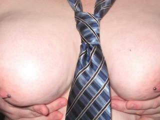 would love to take your tie and restrain your hands as I slide my hard cock between those beautiful tits so you could lick me as I slide through