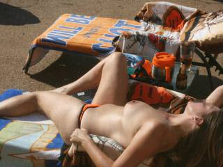 More topless tanning on the patio.