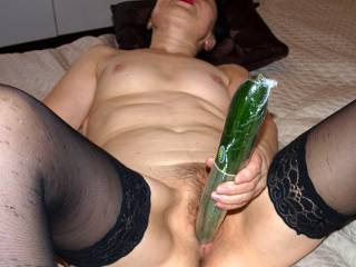 Stuffing her horny cunt with a large cucumbeer u wanna help?
