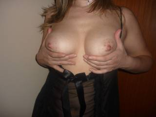 Feeling your nipples stiffen in my mouth ... then I rub my slippery cock all over them ...