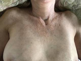 I love looking at and playing with her lovely breasts.