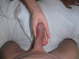 I love to feel his lovely smooth shaven cut cock hardening and growing in my hand.