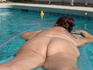 My ass in the pool, naked, as always.
