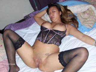 mmmmm, looks very sexy and i love those sheer stockings on her!