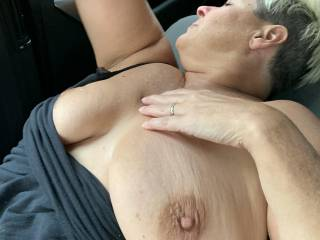 The wife showing her big tits  off going down the road.