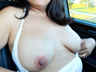 Out for a drive and pulling my tits out in the car!