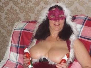 2 little Santa's sucking on my tits. naughty little little Santa's .