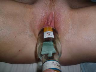 Glass of wine anyone? Fucking my pussy with a wine bottle, going in.