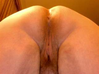 mmm  perfect view  I will lick both them rub my cock on them until It picks a hole   He would love to do both  so you tell me whcih hole to CUM in