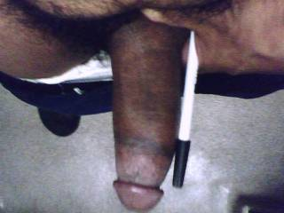 My cock next to a six inch pen