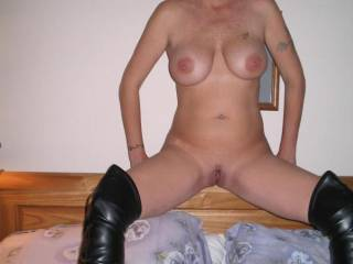 Oh yea, and the boots are sexy too.  You do look sexy with your legs spread sweetie.