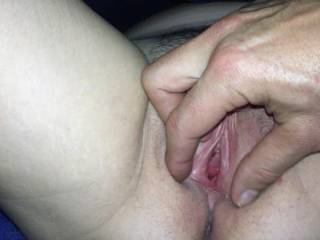 I love her exposed pussy, and I also enjoy the way you show it. I lie between MY partner's spread legs and enjoy the sight of her pussy just like you're doing here.  I really like this one!