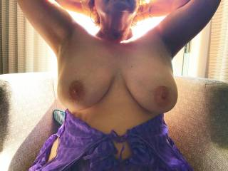 Big natural 38 DD tits by the balcony