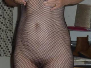 Fabulous body, and I love the sexy fish nets.