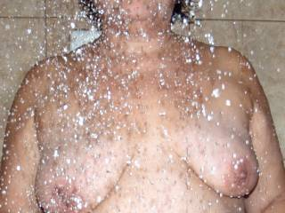 Cum play with my tits under the hot water!
