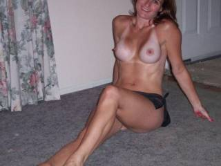 I'd love to be standing over her with my cock in her mouth....letting her suck me off.  Mmmmm, I'd fill her mouth with a huge load of cum.  I can bet she sucks cock real good.  She has nice breasts and a hot body. G