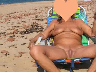 On the beach. Who could resist that sweet pussy outdoors, on a nude beach, with other people around to see you.
