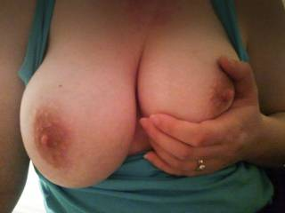 No need for fancy lingerie when the wife can just pop her tits out like this.  Love sucking them.  Tribute anyone? :)