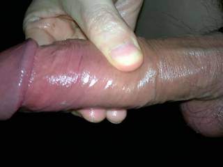 My big cock, all oiled up and his balls tied up so he has to stayb erect. You can see him shining?