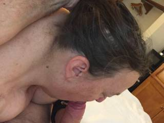 Handful of hair while I pump my cock into her wet mouth.
