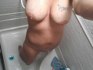 Wife taking an afternoon shower and feeling friendly as always.