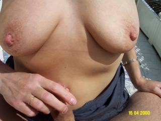 Wow! Beautiful tits! I'd love to lick and suck her juicy nipples.