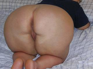 Honey is doggy style ass-up waiting patiently for a creamy load