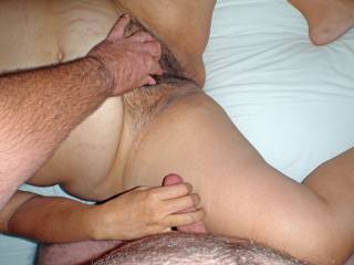 Summer 2008 beach condo vacation.  Hubby plays with my pussy while I stroke his cock!