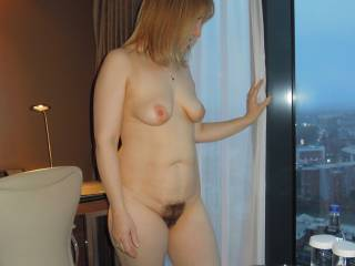 my nude wife looking out from the hotel