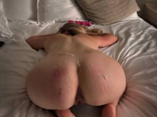 After some licking, fingering, choking, toying, spanking, fucking I cum all over her beautiful thick white arse.