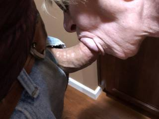 Her lips and warm mouth feel so good wrapped around my mature cock.