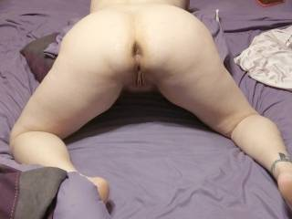 Kitten on her knees showing off her tight ass and pussy...What do you think?