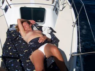 The wife topless on the boat.