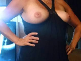 My wife showing off her boobs. Wished she dressed like this for my friends.