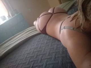 Nikki lying on the bed showing me that perfect body.