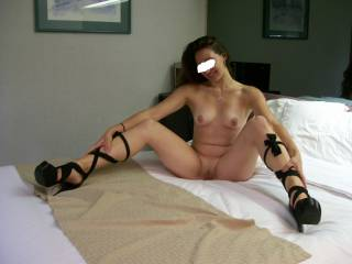 We were on vacation, in the shittiest hotel room in the world, yet I was a bit horny so I got out my shoes, stripped down, and had a good night!