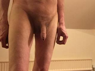 This may well be what you would see if you were sat on the floor as I stood next to you.   I am hoping that my flaccid cock and foreskin will be enough of an attraction for you to reach out and take hold.