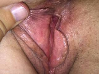 Spreading her pussy lips