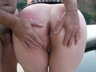 My spanked bum by the pool