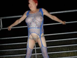 Hi all just a few of me posing by the gates at night dirty comments welcome mature couple