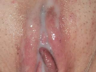 The mrs. pussy overflowing with cum.