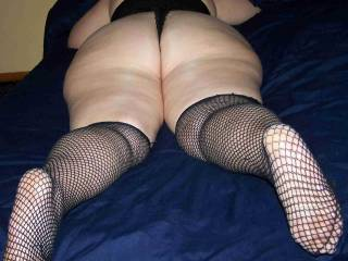 Such a sexy ass!  And I love the fishnets!!!