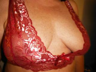 Mrs. Mclovin showing off her red lace bra.