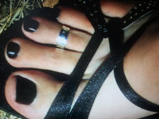 Gorgeous especially love the toe ring...would live to feel it sliding back and forth over the head of my cock. Sexy feet n toes beautiful!